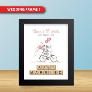 Realistic White and Black Blank Square Picture frame, standing on Light Wood Floor atWhite Wall from the Front. Design Template for Mock Up.